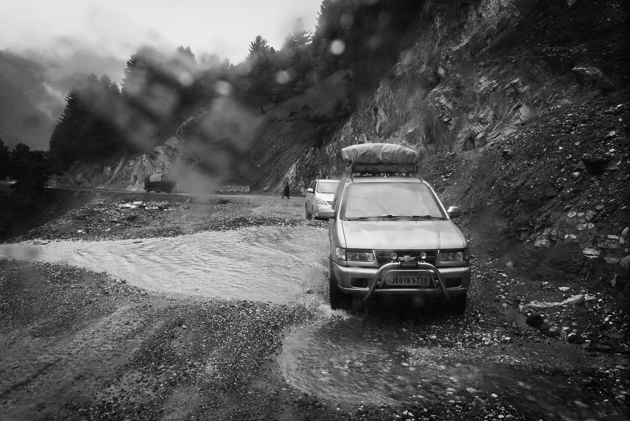 car drives through flooded street on srinagar leh highway