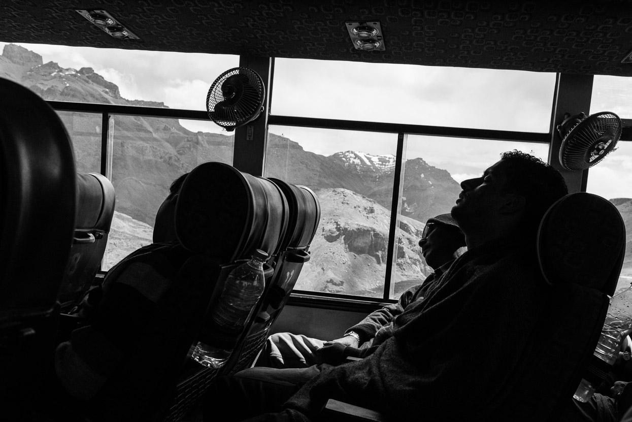 sleeping passengers on bus on manali leh highway