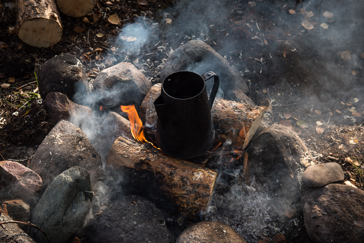 Cooking tea over camp fire