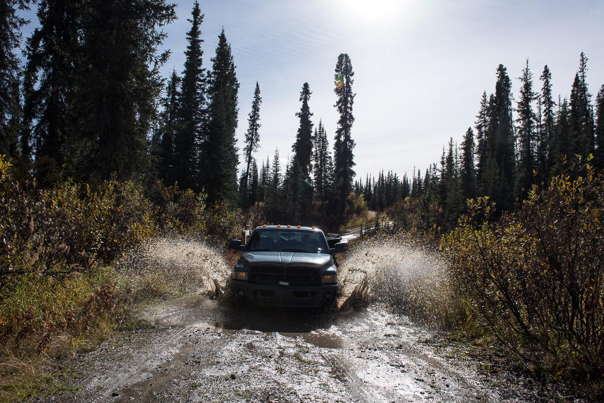 Pickup truck driving through mud in the Yukon