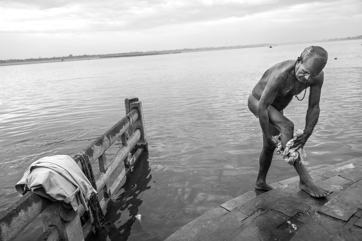 Man after a bath in Ganges in Varanasi India