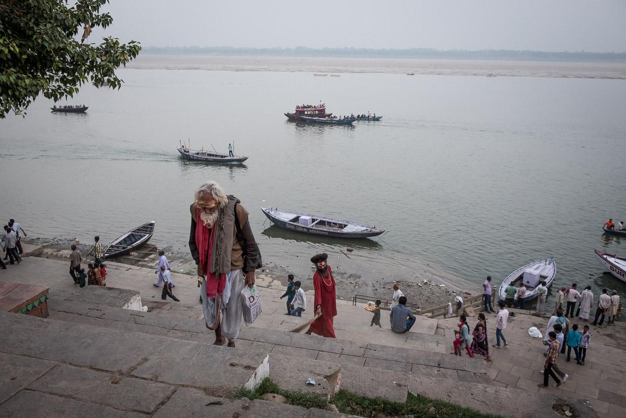 holi men climbing the steps at dandi ghat in Varanasi