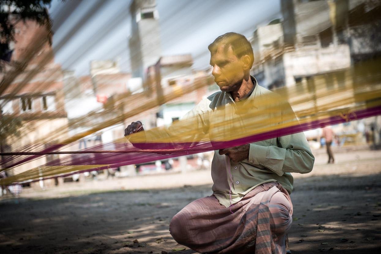 stretching the silk threads for a banarasi silk saree in Varanasi