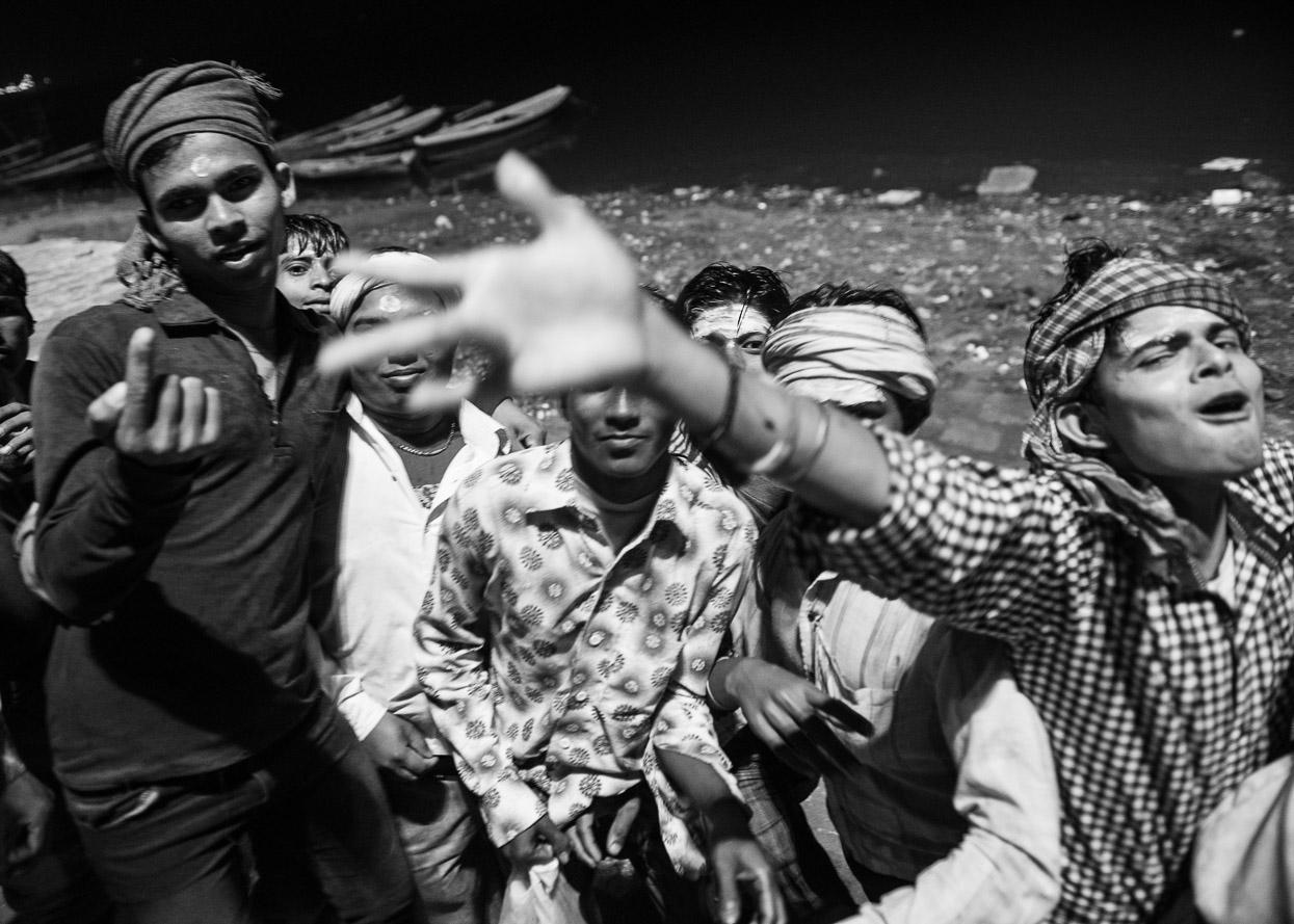 boys celebrating shivratri along ganges in Varanasi India