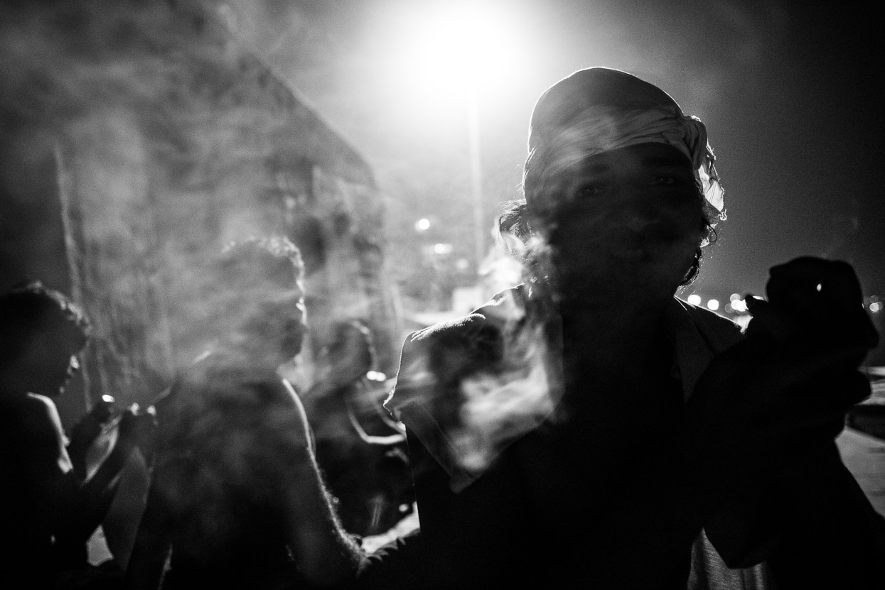 Shiva and his friends smoking a chillum at the ghats in Varanasi at night