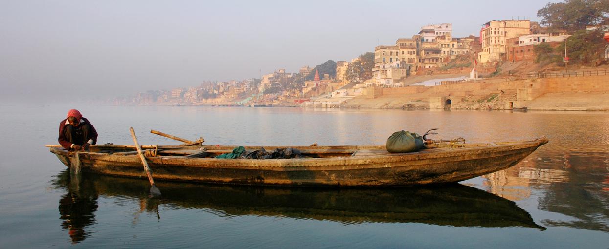fisherman on ganges in Varanasi early morning